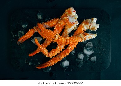 Crab legs on dark background