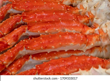 Crab legs on the market, food background