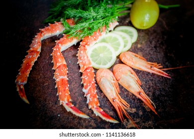 Crab legs on  rustic background