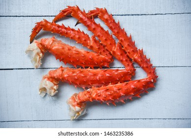 Crab Legs on wood background / Alaskan King crab hokkaido seafood