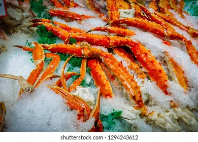 Crab legs sitting on ice at a market in Seattle, Washington.