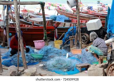 Crab netting and fisherman