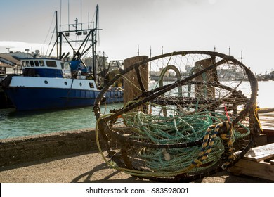 crab pot with fishing boat in background