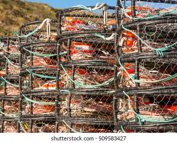 Crab Pots stacked beside the dock waiting for the season to open. Bodega Bay, California.