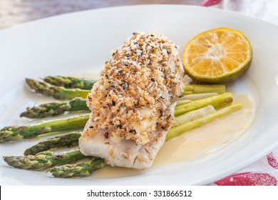 Crab and pumpkin crusted Mahi Mahi with asparagus and Calamansi butter