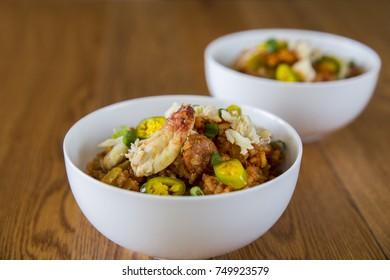 Crab Seafood Spicy Hot Jambalaya Bowl with Fresh Healthy Ingredients
