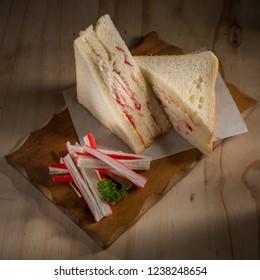 Crab stick sandwich, Sandwich on wooden background, copy space, selective focus