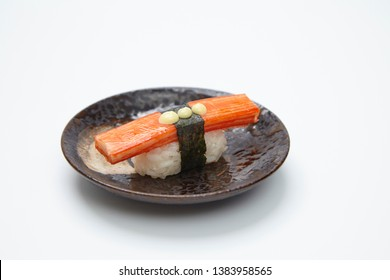 Crab stick sushi or Japanese kani sushi set on black plate.