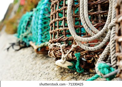 Crab/lobster pots, coastal elements.