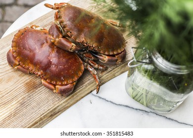 Crabs and dill in preparation for cooking