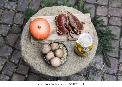 Crabs, mushrooms, pumpkin and pickled potatoes prepared for cooking