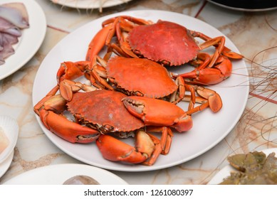 crabs on a white plate