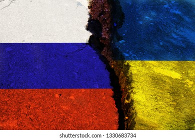 The crack between the flags of Ukraine and Russia