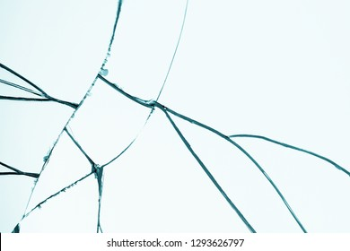 Crack and broken mirror in a front view image. Broken glass. Textured abstract backdrop.