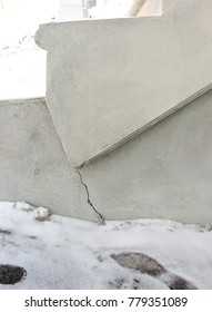 Crack in concrete stairs in winter.  Suitable for experts in foundation repairs