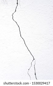 Crack on a white wall