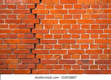Crack in a red brick wall