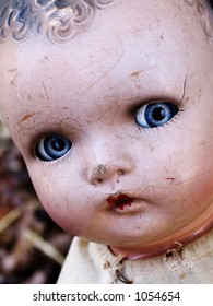 Cracked antique doll face