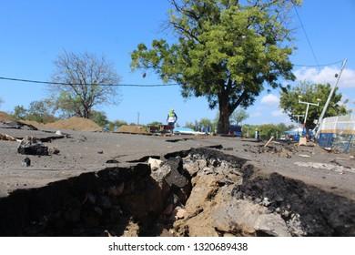 cracked asphalt after earthquake in Lombok Island