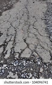 Cracked asphalt road close up