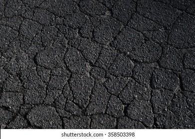 cracked asphalt road surface texture