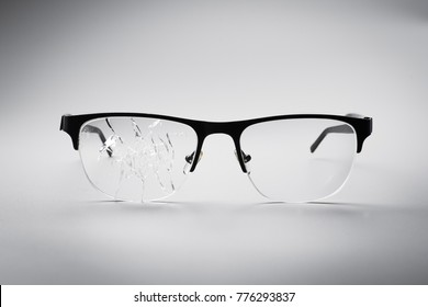 cracked black eye glasses on a white background