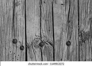 Cracked boards with rusty bolts