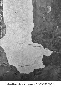Cracked and chapped textured pattern on bare mortar walls for grunge and vintage background concept