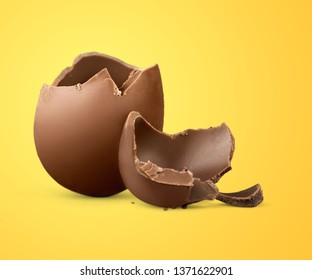 Cracked chocolate Easter egg on white background          - Image