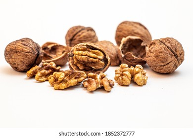 cracked and closed walnuts and their shells