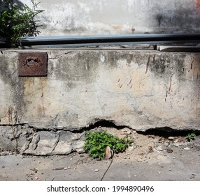 Cracked concrete building wall deep and long holes floor building outside. Foundation old wall moves damaged and collapsed ground. Concept, Ignoring damaged buildings is dangerous. copy space