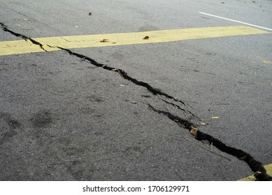 Cracked concrete on the road