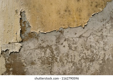 cracked concrete wall covered with gold cement surface as backgr