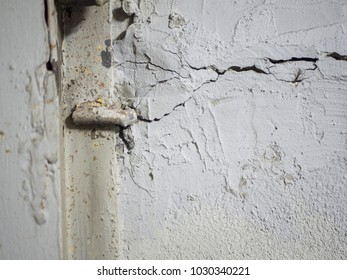 Cracked concrete wall. Gray cement surface as background