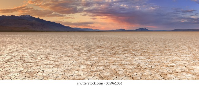 Cracked earth in the Alvord Playa, a dry lakebed in the Alvord Desert in southeastern Oregon, USA. Photographed at sunset.