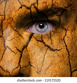 Cracked earth pattern on man face