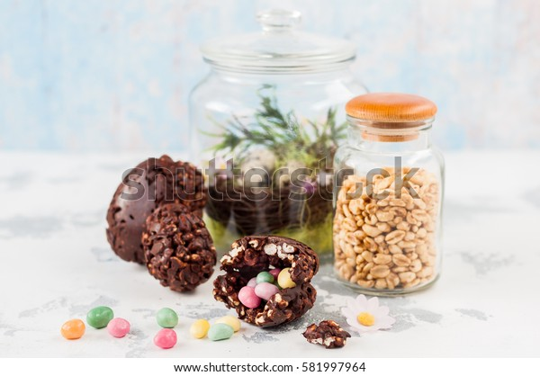 Cracked Easter Chocolate and Puffed Wheat Egg with Hidden Surprise Candies, copy space for your text