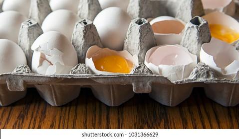 Cracked eggs in a carton