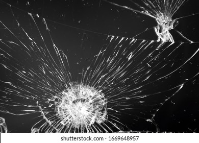 Cracked glass close-up. Background concept.