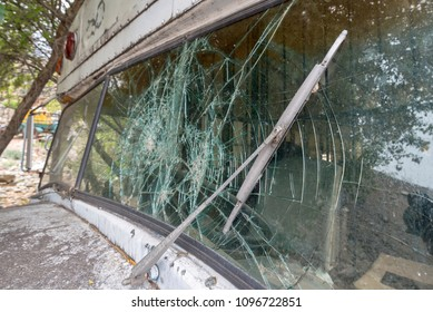 cracked glass of an old bus