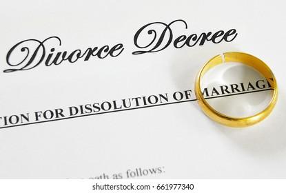 cracked gold wedding ring on a divorce decree