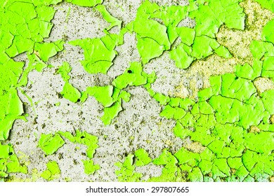 Cracked green paint on a stone surface as a background image