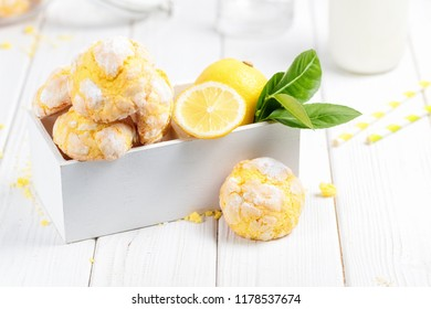 Cracked Lemon cookies on white wooden box, on white background