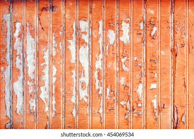 cracked old paint. shabby wooden wall. bright orange color. photo for the backdrop