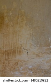 Cracked old pale plastered wall background textures