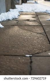 Cracked pavement of an urban neighborhod