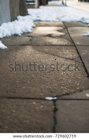Cracked pavement of an urban neighborhod
