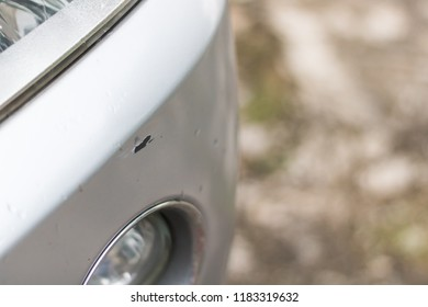 Cracked and peeling paint on car.
