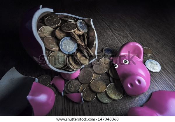 cracked pink pig moneybox closeup