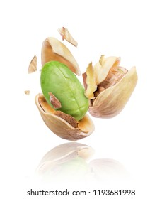 Cracked pistachios close-up isolated on white background
